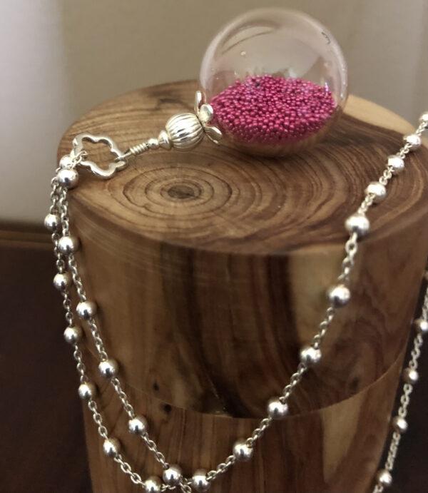 perle soufflée verre transparent micro perles rose vendu sans chaine